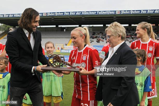 Mandy Islacker of Bayern Muenchen receives an award for scoring the most goals during the last season of the Allianz Frauen Bundesliga at Stadion an...