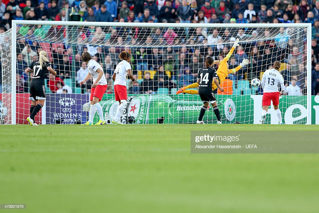 Mandy Islacker (L) of Frankfurt scores the winning goal during the UEFA Women's Champions League final match between 1. FFC Frankfurt and Paris St. Germain at Friedrich-Ludwig-Jahn Sportpark on May 14, 2015 in Berlin, Germany.