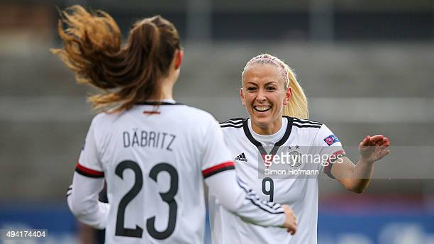 Mandy Islacker of Germany celebrates her team's first goal with team mate Sara Daebritz during the UEFA Women's Euro 2017 Qualifier match between...