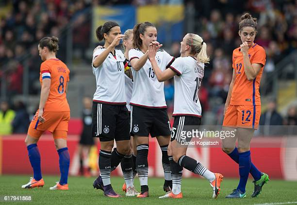 Mandy Islacker of Germany celebrates his team's first goal with team mates Dzsenifer Marozsan Tabea Kemme and Sara Daebritz during the Women's...