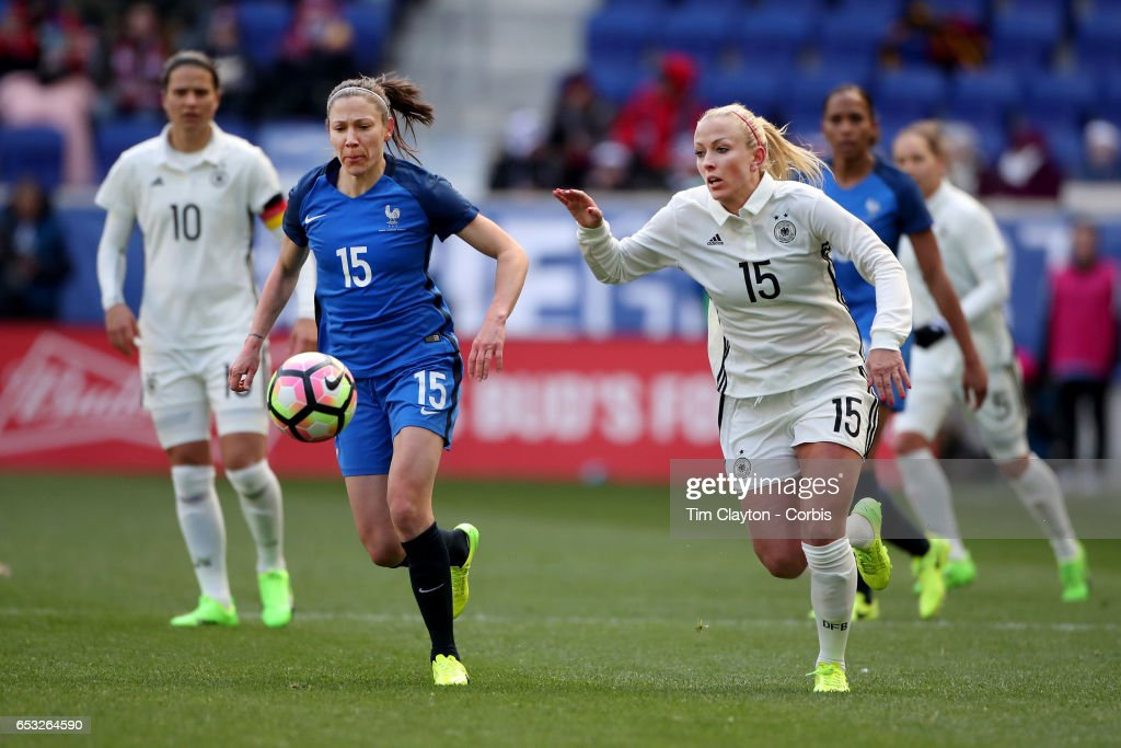 Mandy Islacker #15 of Germany challenged by Elise Bussaglia #15 of France during the France Vs Germany SheBelieves Cup International match at Red Bull Arena on March 4, 2017 in Harrison, New Jersey.