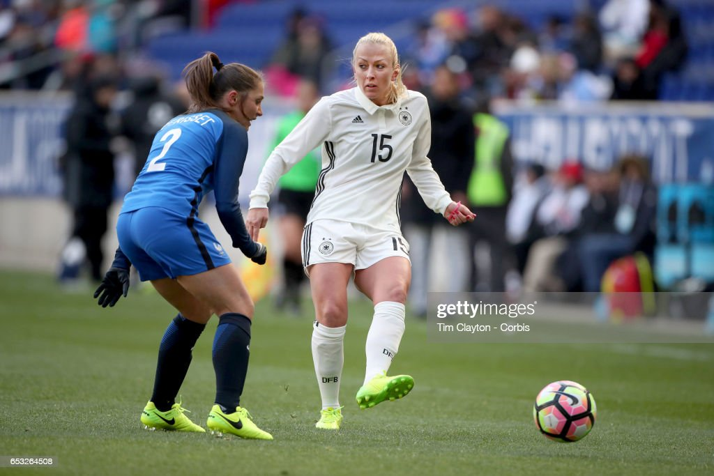 Mandy Islacker #15 of Germany challenged by Eve Perisset #2 of France during the France Vs Germany SheBelieves Cup International match at Red Bull Arena on March 4, 2017 in Harrison, New Jersey.