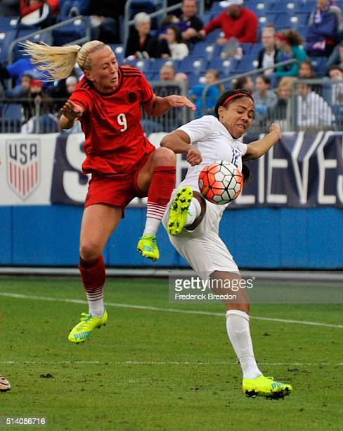Mandy Islacker of Germany collides with Alex Scott of England during the first half of a friend international match of the Shebelieves Cup at Nissan...