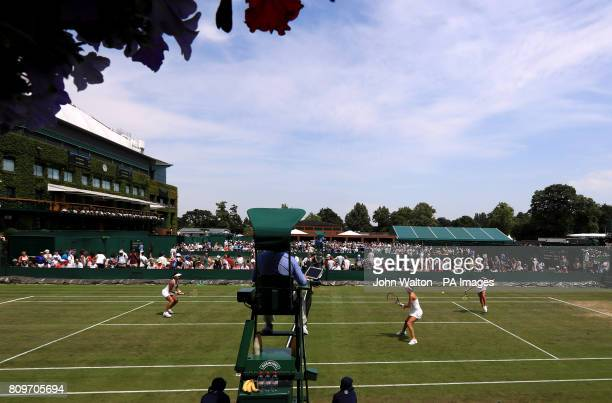 Mandy Minella and Anastasija Sevastova in action during their Doubles match on day four of the Wimbledon Championships at The All England Lawn Tennis...