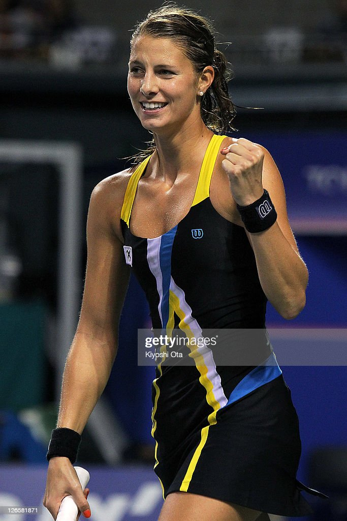 <a gi-track='captionPersonalityLinkClicked' href=/galleries/search?phrase=Mandy+Minella&family=editorial&specificpeople=3378502 ng-click='$event.stopPropagation()'>Mandy Minella</a> of Luxembourg celebrates as she wins her match against Kimiko Date-Krumm of Japan during day two of the Toray Pan Pacific Open at Ariake Colosseum on September 26, 2011 in Tokyo, Japan.