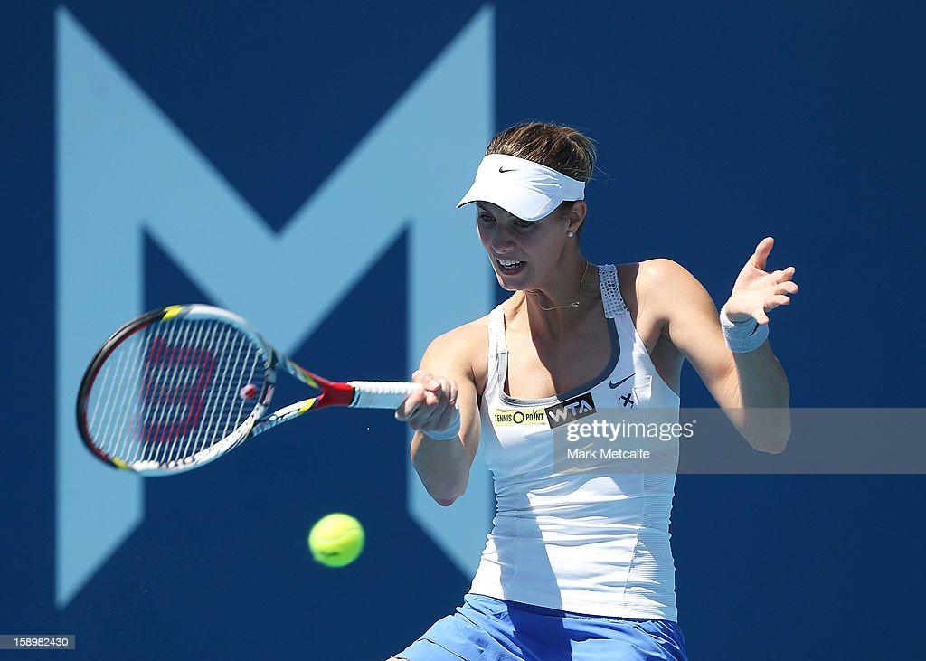 Mandy Minella of Luxembourg plays a forehand in her qualifying singles match with Yuxuan Zhang of China during day two of the Hobart International at Domain Tennis Centre on January 5, 2013 in Hobart, Australia.