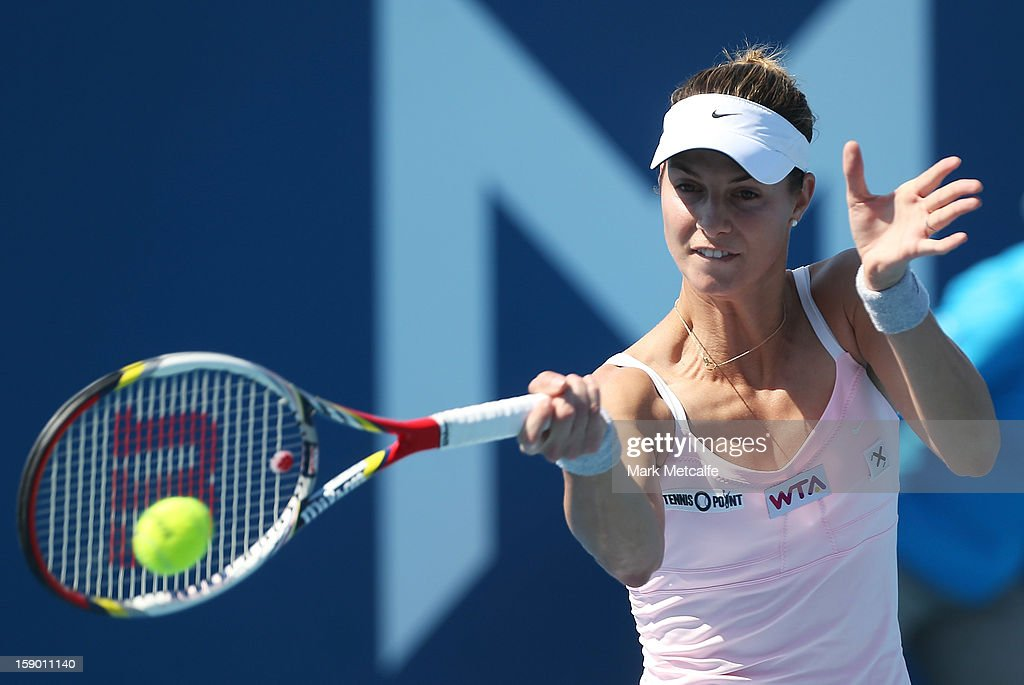 Mandy Minella of Luxembourg plays a forehand in her qualifying singles match with Garbine Muguruza of Spain during day three of the Hobart International at Domain Tennis Centre on January 6, 2013 in Hobart, Australia.