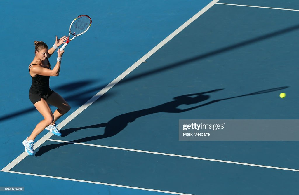 <a gi-track='captionPersonalityLinkClicked' href=/galleries/search?phrase=Mandy+Minella&family=editorial&specificpeople=3378502 ng-click='$event.stopPropagation()'>Mandy Minella</a> of Luxembourg plays a forehand partnering Timea Babos of Hungary in their doubles semi final match against Lara Arruabarrena-Vecino and Lourdes Dominguez Lino of Spain during day eight of the Hobart International at Domain Tennis Centre on January 11, 2013 in Hobart, Australia.