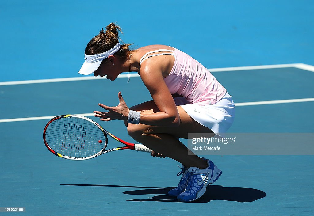 <a gi-track='captionPersonalityLinkClicked' href=/galleries/search?phrase=Mandy+Minella&family=editorial&specificpeople=3378502 ng-click='$event.stopPropagation()'>Mandy Minella</a> of Luxembourg reacts to losing a point in her qualifying singles match with Rebecca Marino of Canada during day one of the Hobart International at Domain Tennis Centre on January 4, 2013 in Hobart, Australia.