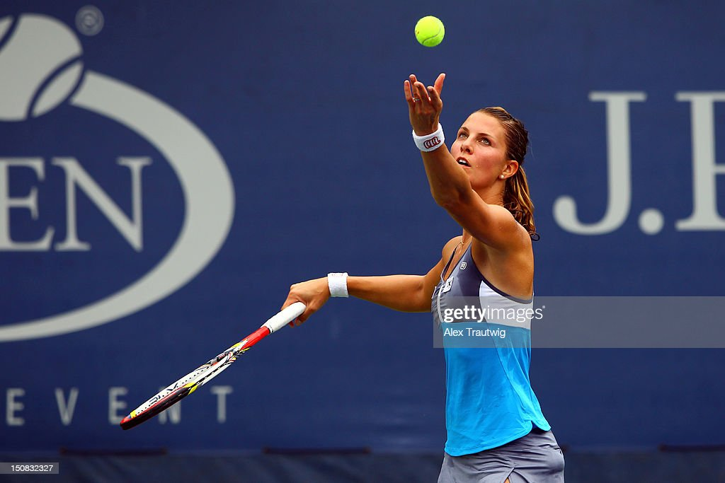 <a gi-track='captionPersonalityLinkClicked' href=/galleries/search?phrase=Mandy+Minella&family=editorial&specificpeople=3378502 ng-click='$event.stopPropagation()'>Mandy Minella</a> of Luxembourg serves against Olivia Rogowska of Australia during their women's singles first round match Day One of the 2012 US Open at USTA Billie Jean King National Tennis Center on August 27, 2012 in the Flushing neigborhood of the Queens borough of New York City.