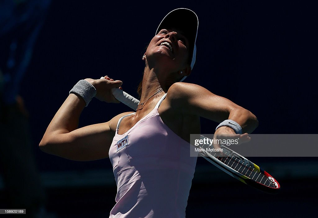 <a gi-track='captionPersonalityLinkClicked' href=/galleries/search?phrase=Mandy+Minella&family=editorial&specificpeople=3378502 ng-click='$event.stopPropagation()'>Mandy Minella</a> of Luxembourg serves in her qualifying singles match with Rebecca Marino of Canada during day one of the Hobart International at Domain Tennis Centre on January 4, 2013 in Hobart, Australia.