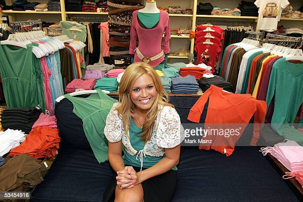 Mandy Moore poses at the launch of her clothing line Mblem at Fred Segal on August 23 2005 in Santa Monica California