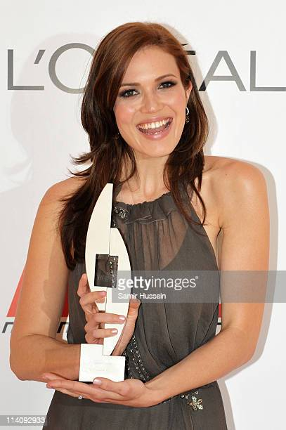 Mandy Moore poses with the Animation award won for Tangled in the Press Room during The L'Oreal National Movie Awards at Wembley Arena on May 11 2011...