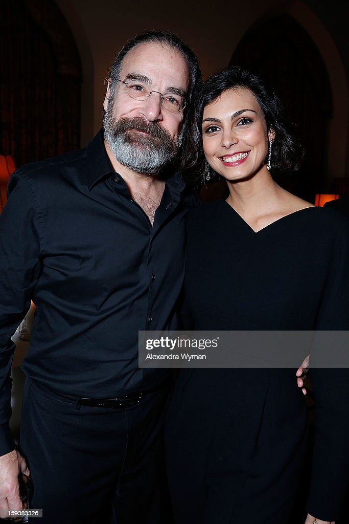 <a gi-track='captionPersonalityLinkClicked' href=/galleries/search?phrase=Mandy+Patinkin&family=editorial&specificpeople=233720 ng-click='$event.stopPropagation()'>Mandy Patinkin</a> and <a gi-track='captionPersonalityLinkClicked' href=/galleries/search?phrase=Morena+Baccarin&family=editorial&specificpeople=812774 ng-click='$event.stopPropagation()'>Morena Baccarin</a> at Showtime's dinner celebration of The 2013 Golden Globe Nominees held at The Chateau Marmont on January 12, 2013 in Los Angeles, California.