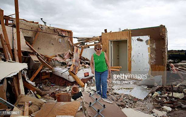 Mandy Pletcher walks past her safe room which withstood a tornado May 25 2011 in Piedmont Oklahoma The state medical examiner's office said there...