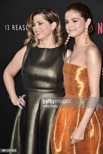 Mandy Teefey and Selena Gomez attend the premiere of Netflix's '13 Reasons Why' at Paramount Pictures on March 30 2017 in Los Angeles California