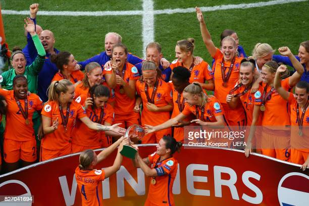 Mandy van den Berg and Sherida Spitse of the Netherlands hand out the winning to their team during the Netherlands v Denmark UEFA Women's Euro 2017...