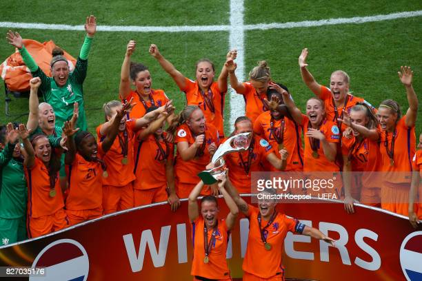 Mandy van den Berg and Sherida Spitse of the Netherlands lift the lifts the trophy on the podium after winning the Netherlands v Denmark UEFA Women's...