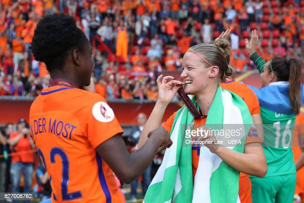 Mandy van den Berg of the Netherlands and Jill Roord of the Netherlands celebrate following the Final of the UEFA Women's Euro 2017 between...