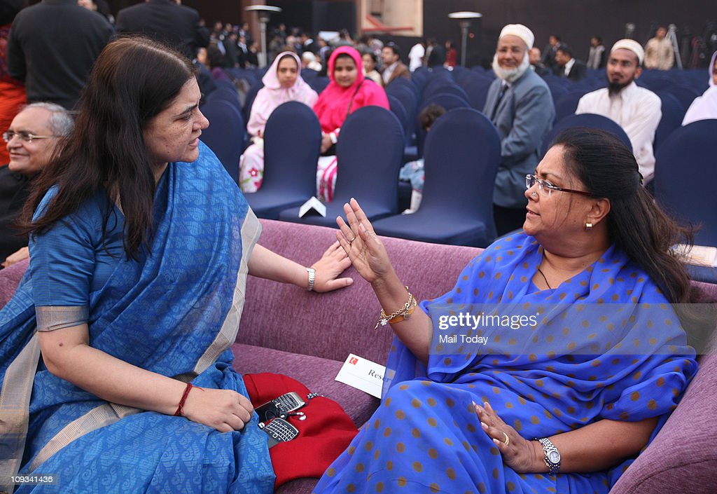 Maneka Gandhi and Vasundhara Raje during the launch of the book 'Impressions' written by BJP leader Najma Heptullah in New Delhi on Monday