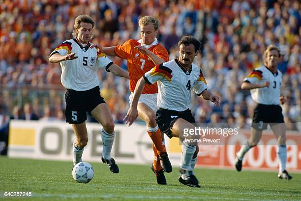 Manfred Binz Dennis Bergkamp and Jurgen Kohler during the 1992 UEFA European Football Championship Netherlands vs Germany