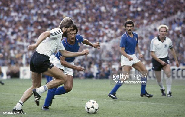 Manfred Kaltz of West Germany moves past Gaetano Scirea of Italy during the FIFA World Cup Final between Italy and West Germany at the Santiago...
