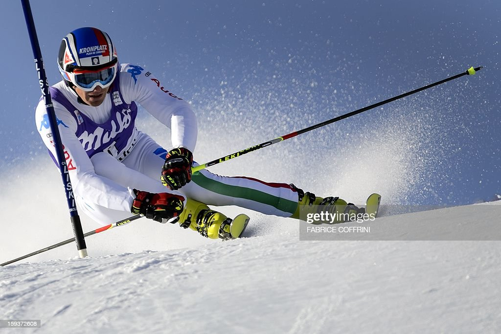 Manfred Moelgg of Italy clears a gate during the first run to place 4th in the men's giant slalom race at the FIS Alpine Skiing World Cup on January 12, 2013 in Adelboden.