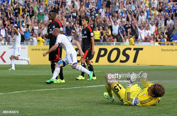 Manfred Starke of Jena celebrates the fifth goal by Johannes Pieles Goalkeeper Rene Adler of Hamburger SV on the ground during the First Round of...