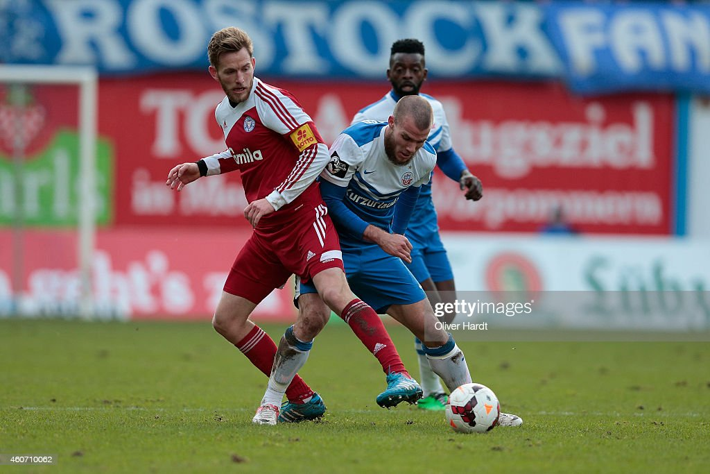 Manfred Starke of Rostock and Mikkel Vendelbo of Kiel compete during the Third League match between Hansa Rostock and Holstein Kiel at DKBArena on...