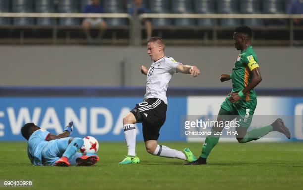 Mangani Banda of Zambia dives at the feet of Philipp Ochs of Germany to save his shot during the FIFA U20 World Cup Korea Republic 2017 Round of 16...