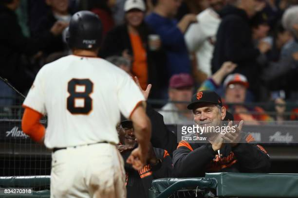 Manger Bruce Bochy smiles after Hunter Pence of the San Francisco Giants scored in the fifth inning against the Philadelphia Phillies at ATT Park on...