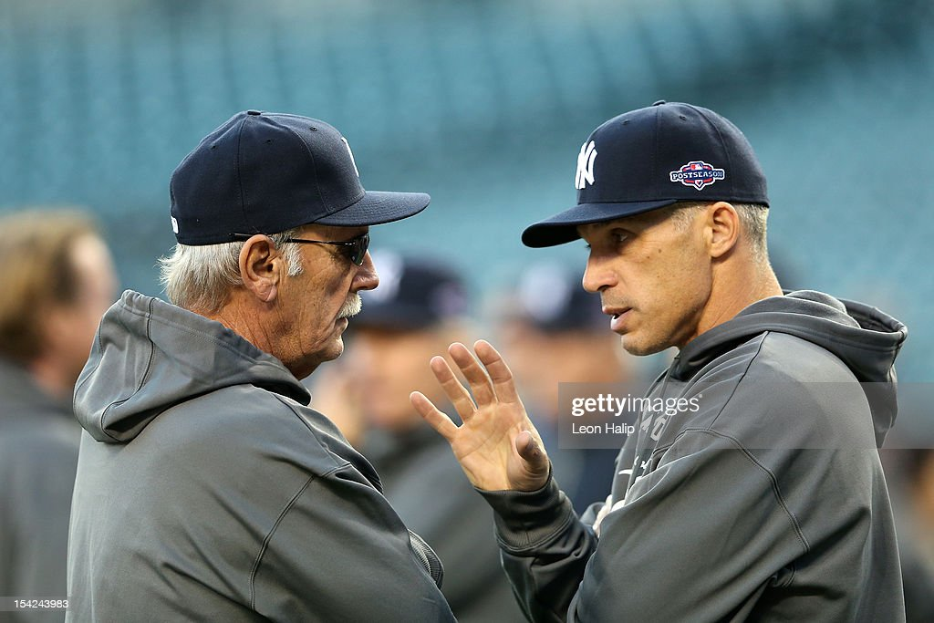 Manger Jim Leyland (L) of the Detroit Tigers talks with manager Joe Girardi of the New York Yankees during batting practice prior to game three of the American League Championship Series at Comerica Park on October 16, 2012 in Detroit, Michigan.