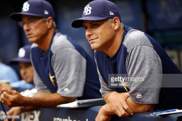 Manger Kevin Cash right of the Tampa Bay Rays and bench coach Tom Foley look on from the dugout before the first inning of a game against the Houston...