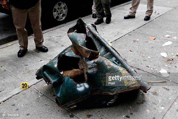 A mangled dumpster sits on the sidewalk at the site of an explosion on September 18 2016 in the Chelsea neighborhood of New York City An explosion in...
