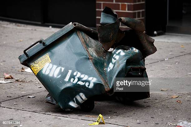 A mangled dumpster sits on the sidewalk on September 18 2016 in the Chelsea neighborhood of New York City An explosion in a construction dumpster...