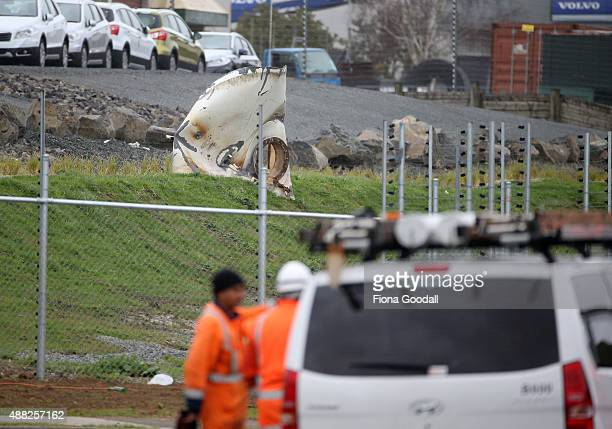A mangled pices of metal sits opposite the site on Bolderwood Place Wiri on September 15 2015 in Auckland New Zealand One person has died and another...
