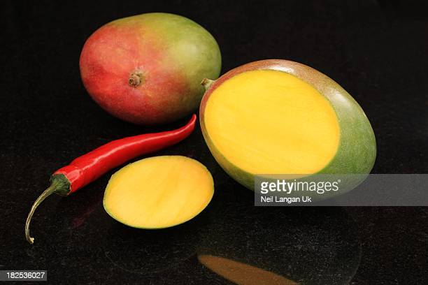 mango and chili on granite background