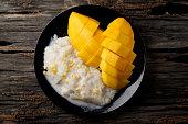 Thai desserts: colorful coconut milk, yellow gram, mango and sticky rice