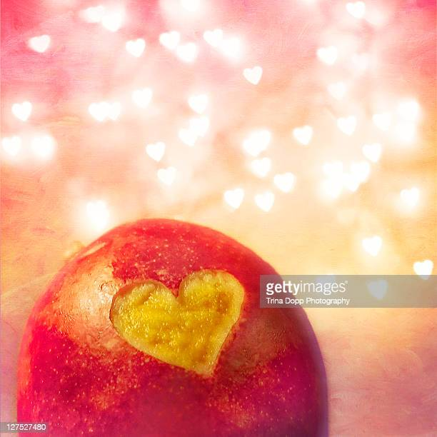 Mango carved with heart and heart-shaped bokeh