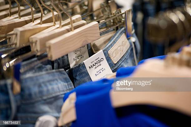 A Mango label is seen on jeans for sale inside a Mango fashion store in Barcelona Spain on Tuesday April 16 2013 Mango has ditched the glitz in favor...