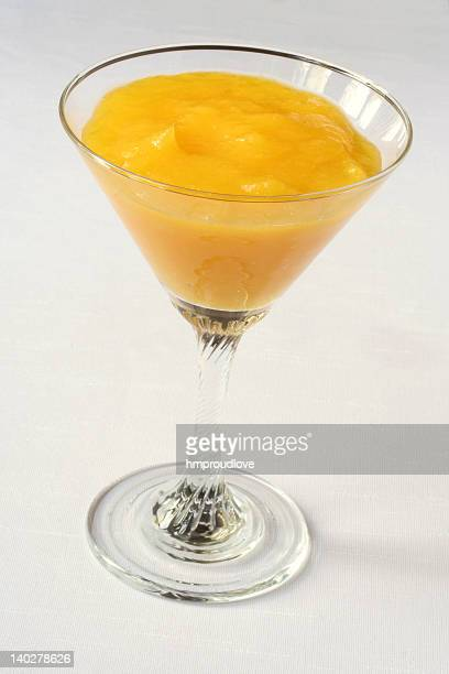 Mango puree in a martini glass