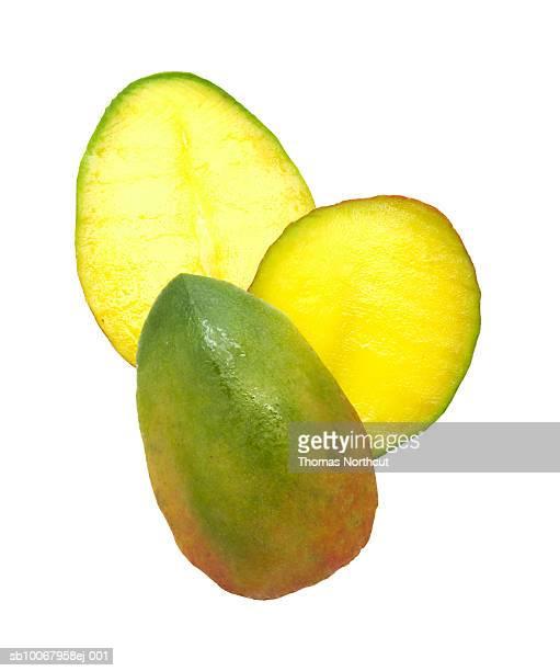 Mango slices on white background