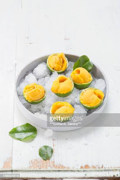 Mango sorbet served in iced limes