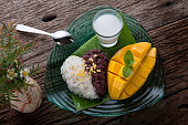 Mango with sticky rice in Thai style dessert of summer time ready to eat .