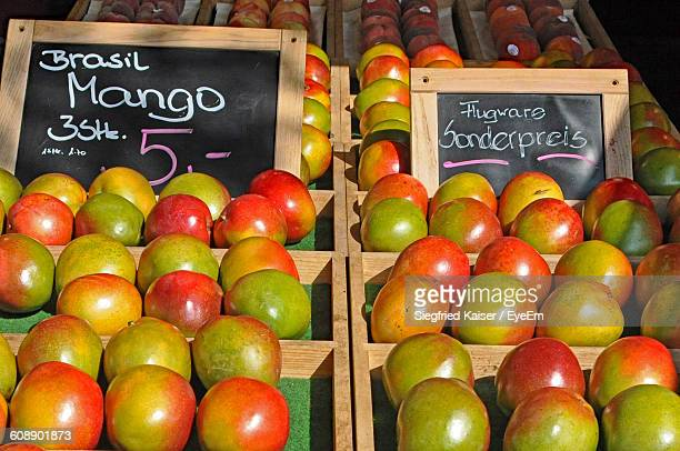 Mangoes In Containers At Market For Sale