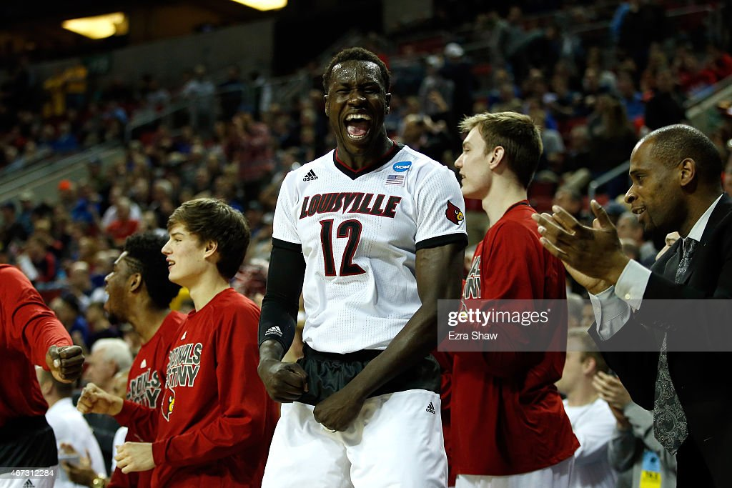 Mangok Mathiang of the Louisville Cardinals celebrates after defeating the Northern Iowa Panthers 66 to 53 during the third round of the 2015 NCAA...