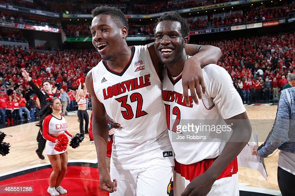 Mangok Mathiang of the Louisville Cardinals celebrates his winning basket with teammate Chinanu Onuaku after the game against the Virginia Cavaliers...