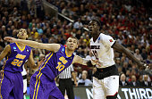 Mangok Mathiang of the Louisville Cardinals looks for the rebound against Seth Tuttle of the Northern Iowa Panthers in the first half of the game...