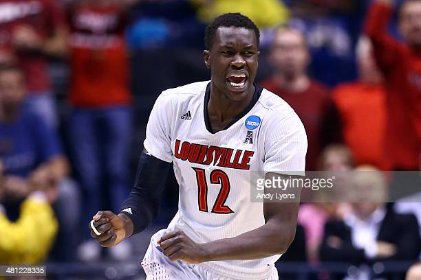Mangok Mathiang of the Louisville Cardinals reacts after points in the first half against the Kentucky Wildcats during the regional semifinal of the...