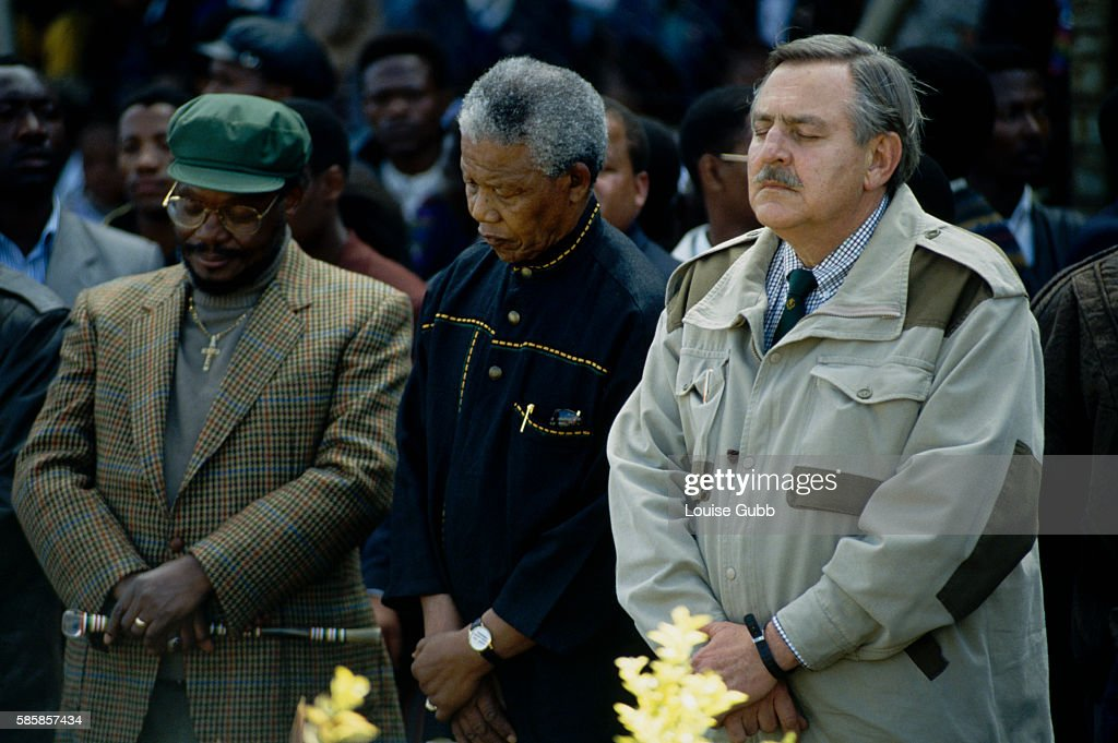 Mangosuthu Buthelezi Nelson Mandela and Roelof 'Pik' Botha praying for peace at an antiwar rally Former President of South Africa and longtime...